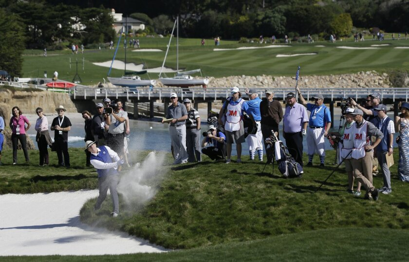 Bill Murray hits out of a bunker up to the 17th green of the Pebble Beach Golf Links during the celebrity challenge event of the AT&T Pebble Beach National Pro-Am golf tournament Wednesday, Feb. 10, 2016, in Pebble Beach, Calif. (AP Photo/Eric Risberg)