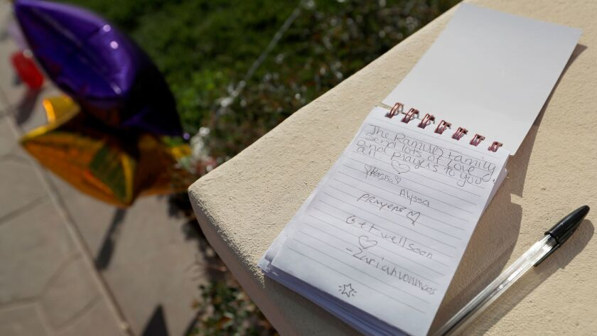 Hand-written notes are part of a growing memorial in Perris for the children of Turpin family.