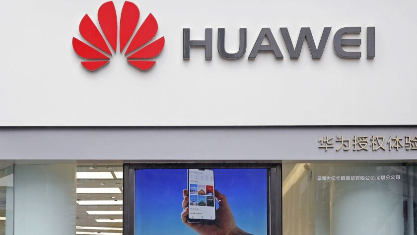 A Huawei logo is displayed at a shop in Shenzhen, China, on Thursday.