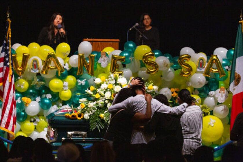 Alma García embraces Juan Cruz, the fiancé of Spec. Vanessa Guillén at her memorial service on Friday, Aug. 14, 2020, in Houston. (Marie D. De Jesús/Houston Chronicle via AP)