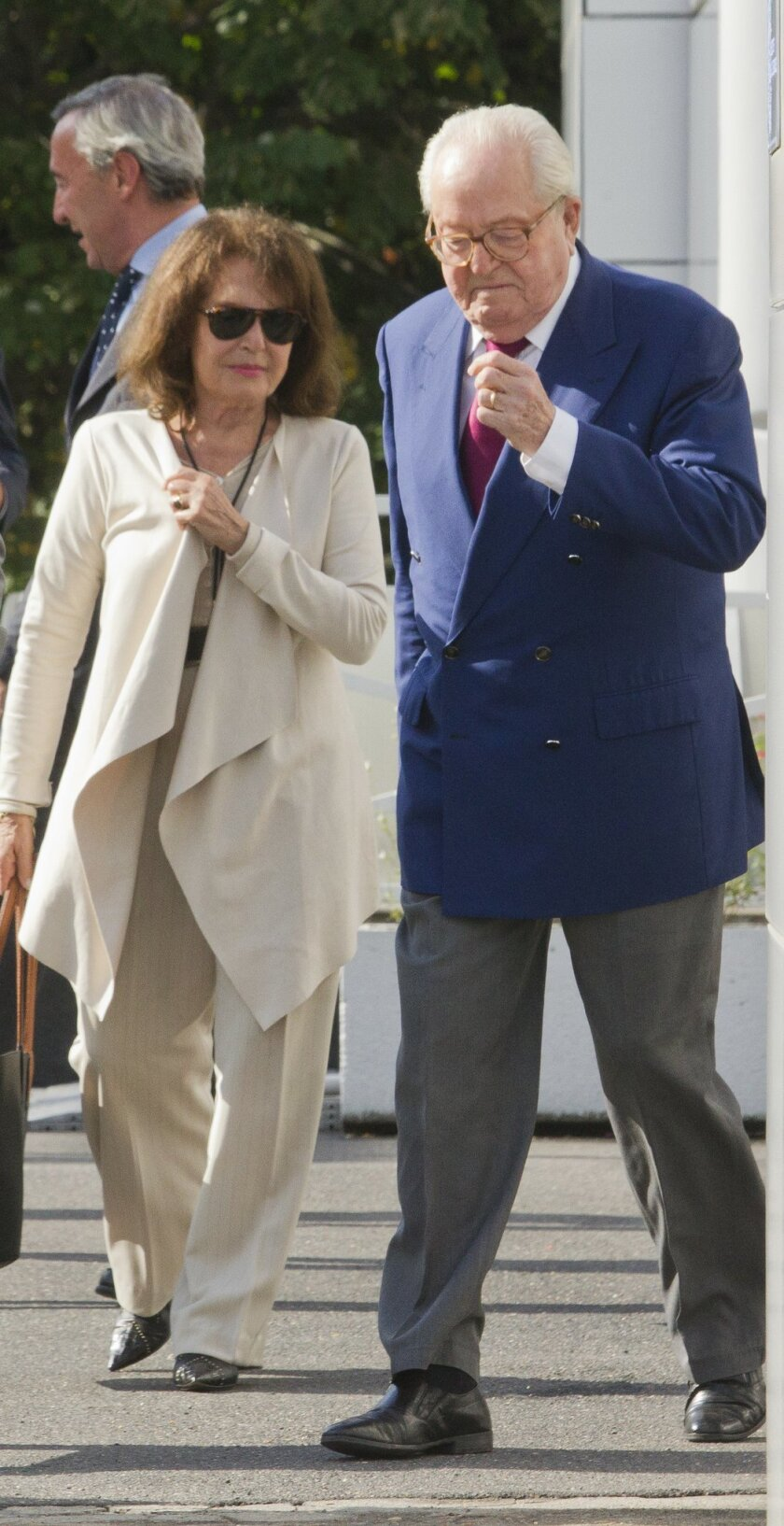 Jean-Marie le Pen, former head of far-right party National Front, and his wife Jany, leave the party headquarters in Nanterre, outside Paris, France, Thursday, Aug 20, 2015, after a meeting to decide whether he would be excluded from the party. (AP Photo/Jacques Brinon)