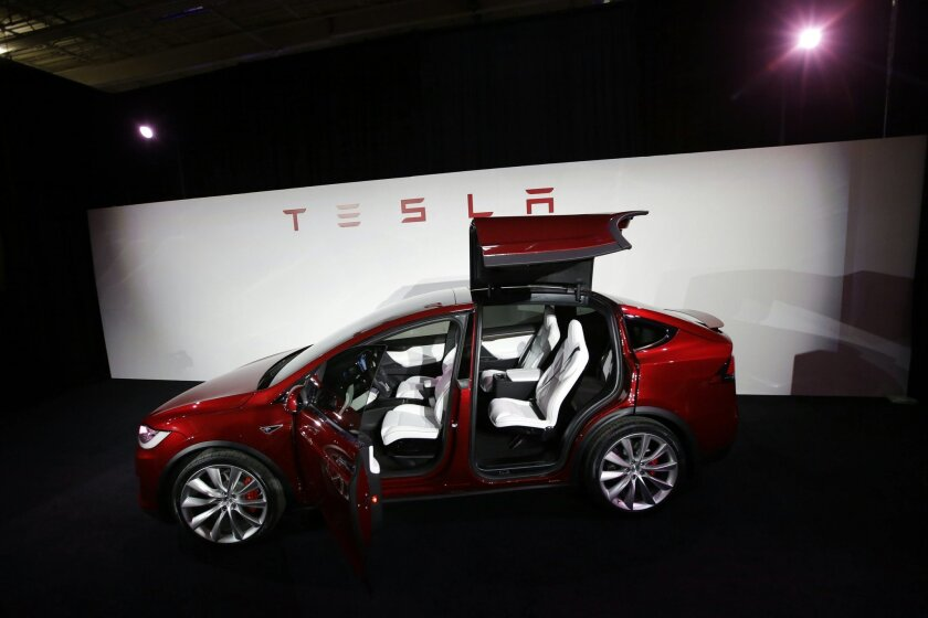 FILE - In this Tuesday, Sept. 29, 2015, file photo, the Tesla Model X car is introduced at the company's headquarters in Fremont, Calif. Tesla reports financial results on Wednesday, Feb. 10, 2016. (AP Photo/Marcio Jose Sanchez, File)