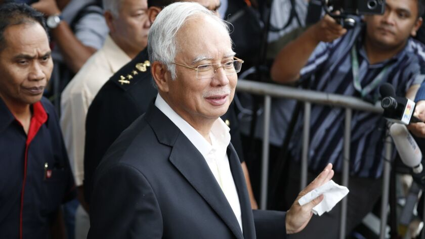 Former Malaysian Prime Minister Najib Razak, center, speaks to media on May 24, 2018.