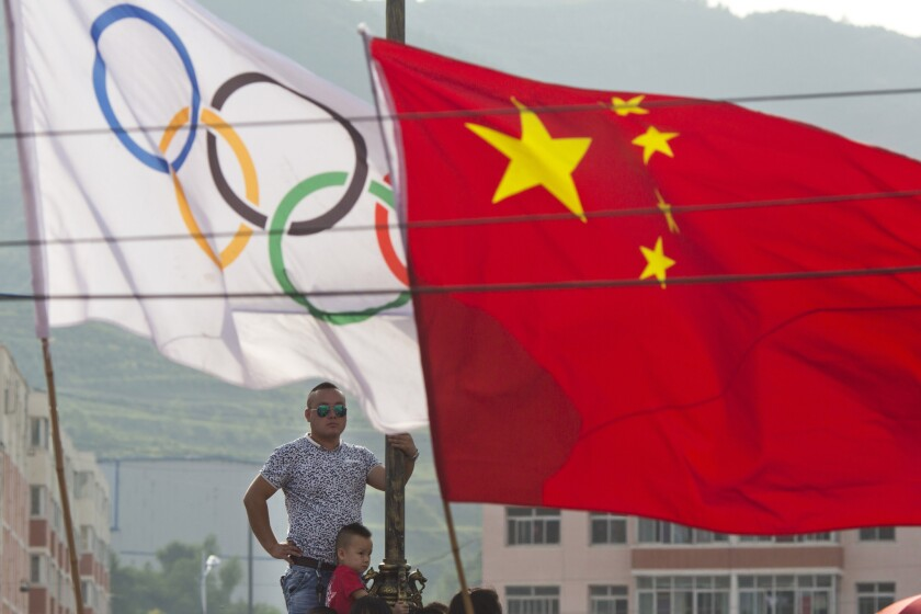 Residents waits for the decision for Beijing to be named the host city for the 2022 Winter Olympics at the ski resort region of Chongli where the Nordic skiing, ski jumping, and other outdoor Olympic events will be held.