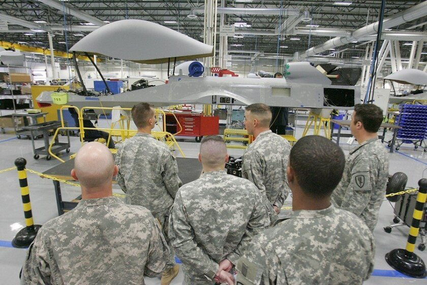 Soldiers trained to fly the unmanned Sky Warrior aircraft looked around the Poway factory where they are being made by General Atomics Aeronautical Systems. The soldiers are from the unmanned aerial systems training battalion at Fort Huachuca, near Tucson.