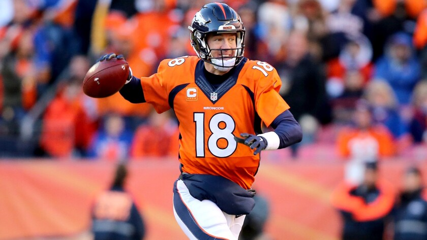 Broncos quarterback Peyton Manning looks to pass against the Steelers while scrambling away from pressure Sunday.