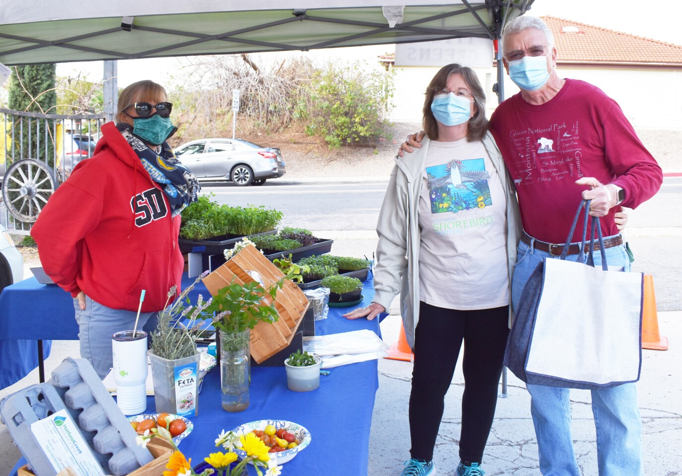 Shannon Glaudini of Hatfield Creek Aquaponics and Farm with customers Debbie and Larry Fontaine.