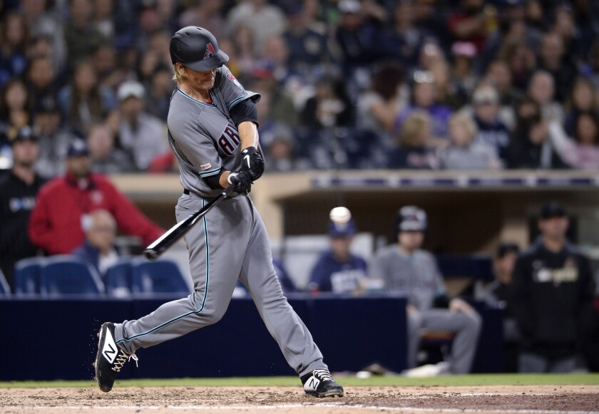 FILE - In this April 2, 2019, file photo, Arizona Diamondbacks pitcher Zack Greinke hits a three-run home run during the fourth inning of a baseball game against the San Diego Padres in San Diego. While pitchers have always been viewed as the weakest link in the batting order, there was a time when they weren't automatic outs. (AP Photo/Orlando Ramirez, File)