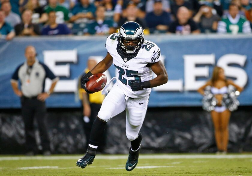 FILE - In this Aug. 21, 2014, file photo, Philadelphia Eagles' LeSean McCoy rushes during the first half of an NFL preseason football game against the Pittsburgh Steelers in Philadelphia. McCoy told anyone who would listen that he wants to run for 2,000 yards. The two-time All-Pro gets to start his quest against a run defense that was fourth-worst in the NFL when the Eagles host the Jaguars in the season opener. (AP Photo/Matt Rourke, File)