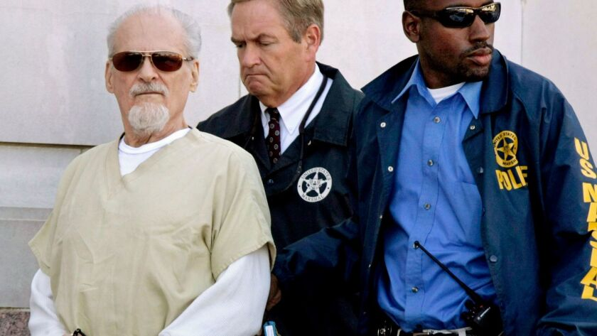 FILE - In this July 23, 2009, file photo, Tony Alamo, left, is escorted to a waiting police car outs