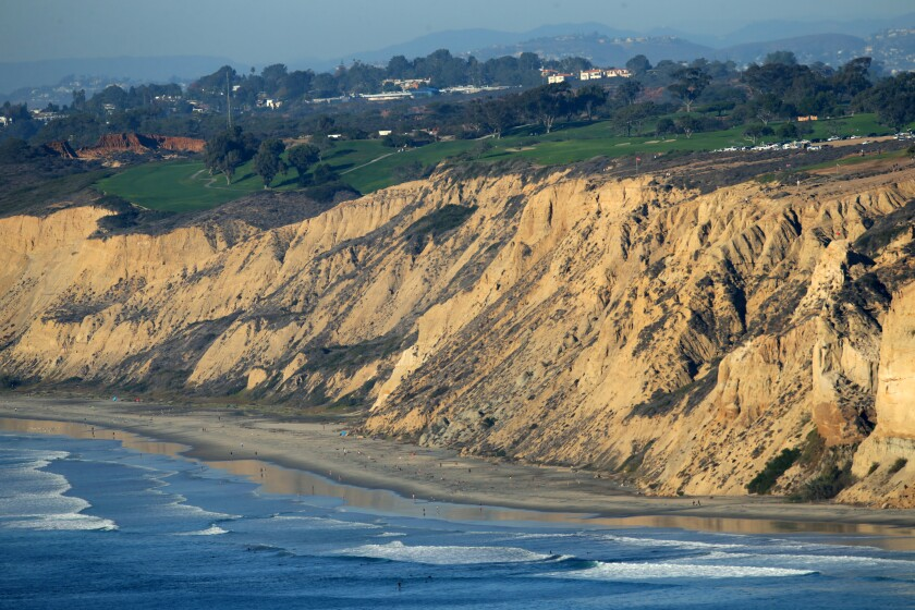 Waves break at below the bluffs of the Torrey Pines Golf Course. Much of San Diego's coastline provides a buffer against flooding.
