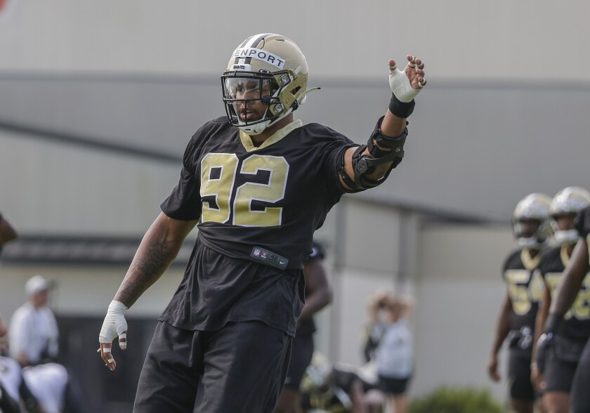 New Orleans Saints defensive end Marcus Davenport (92) stretches during NFL football training camp in Metairie, Friday, July 30, 2021. (AP Photo/Derick Hingle)