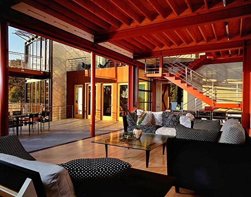 Walls of glass slide aside to connect indoor and outdoor spaces.