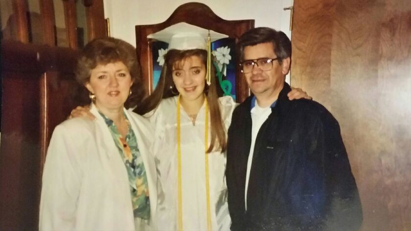 Heidi Peden and her parents, Beverly and Jack Meintsma, on her graduation from Paradise High School