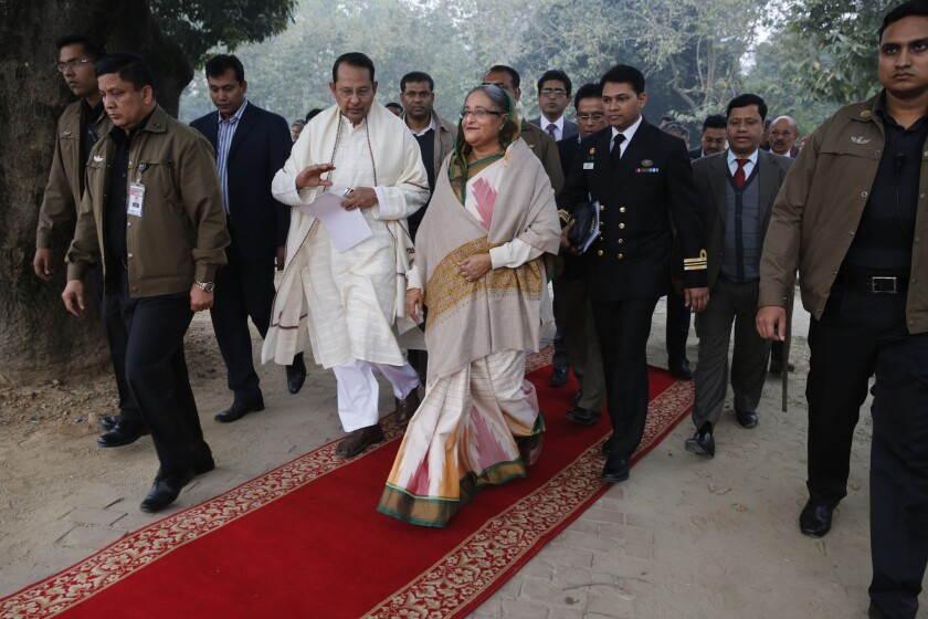 """Bangladeshi Prime Minister Sheik Hasina arrives for a news conference in Dhaka on Monday, a day after her incumbent political coalition scored what commentators called a """"hollow victory"""" in an election marred by opposition boycotts, strikes and economic sabotage."""