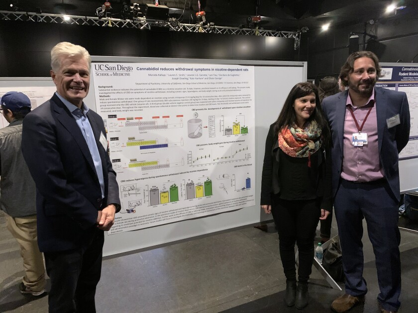 CV Sciences Chief Executive Joseph Dowling stands with UC San Diego researchers Marsida Kallupi and Olivier George.