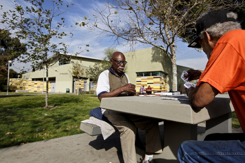 Mack Henry Conley, left, and Michael Jewell play pinochle in January at Fred Roberts Recreation Center in South Los Angeles, an area that is among the most park-poor parts of L.A. County.