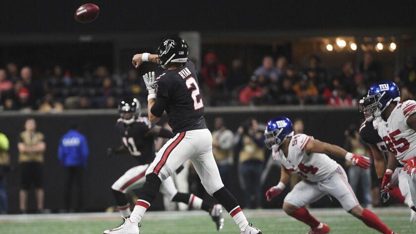 Atlanta Falcons quarterback Matt Ryan (2) works against the New York Giants during the second half o