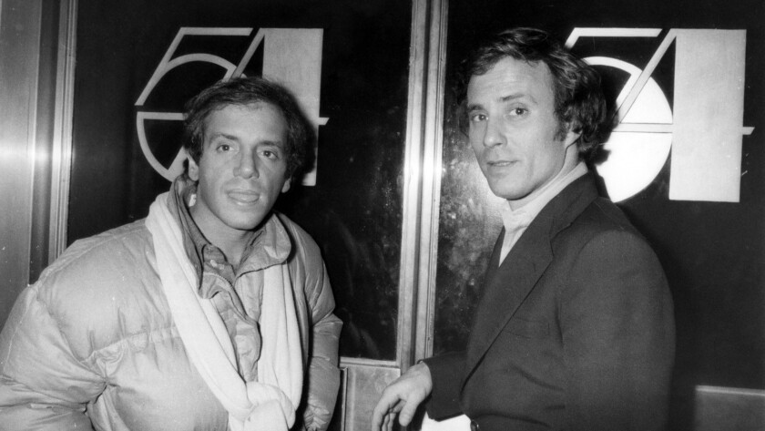 (L-R) - Steve Rubell and Ian Schranger stand outside the door of Studio 54 in New York, City, Decemb