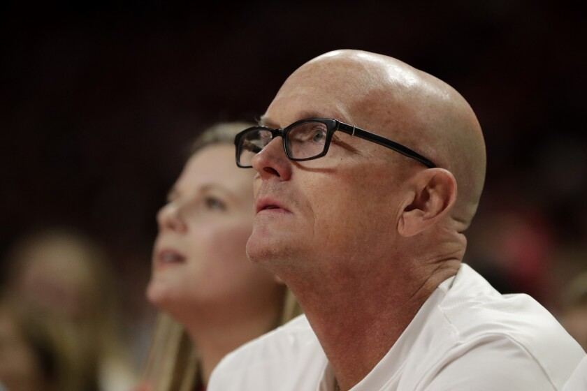 Sports broadcaster Scott Van Pelt watches a shot by Ohio State during the first half of an NCAA college basketball game against Maryland, Tuesday, Jan. 7, 2020, in College Park, Md. (AP Photo/Julio Cortez)