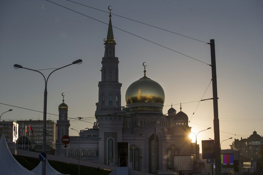 The newly restored Moscow Cathedral Mosque is silhouetted against the sky brightened by the rising sun in Moscow, Russia, Wednesday, Sept. 23, 2015. The mosque was demolished and rebuilt to be one of the biggest mosques in the country with a room for 10,000 believers. Russian President Vladimir Putin, Turkey's President Recep Tayyip Erdogan and Palestinian President Mahmoud Abbas will join the re-opening ceremony of the mosque later in the day. (AP Photo/Pavel Golovkin)