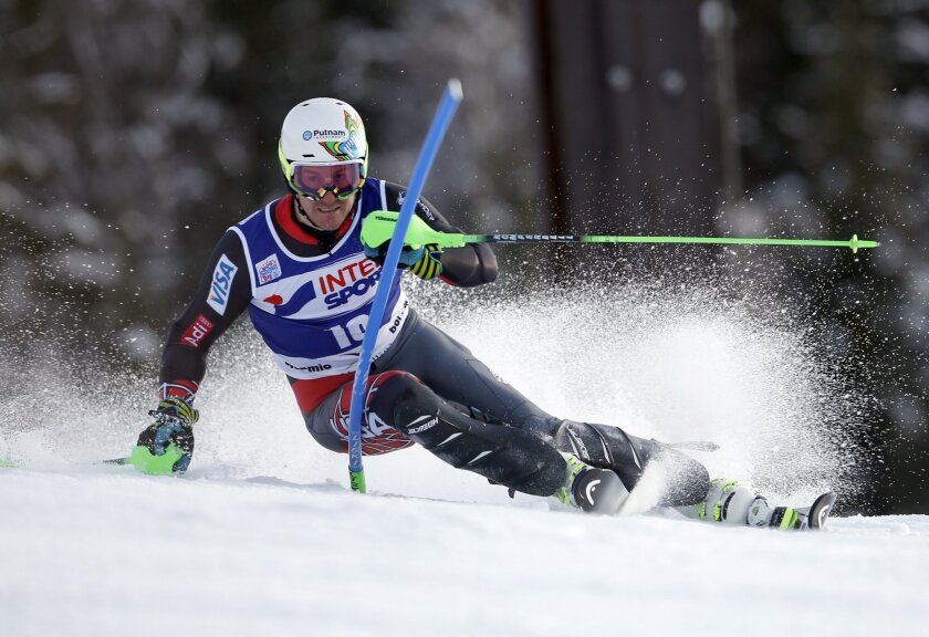 Ted Ligety, of the United States, speeds past a pole during the first run of an alpine ski, men's World Cup slalom, in Bormio, Italy, Monday, Jan. 6, 2013. (AP Photo/Marco Trovati)