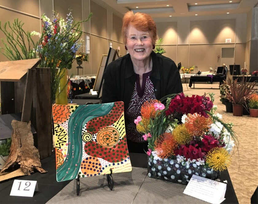 Patti Cooprider created this ceramic plate and a florist designed a matching arrangement. She has long supported the arts.