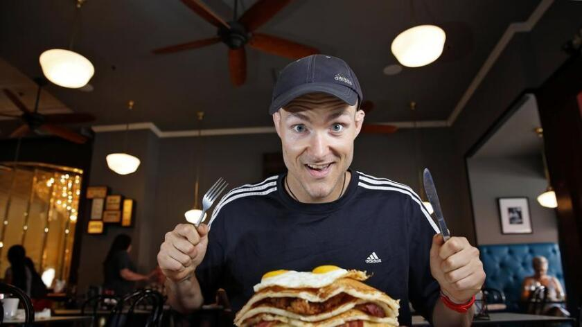 Josh Hockett has completed an impressive amount of food challenges at restaurants around San Diego County, including the Pancake Monster at Brian's 24 in downtown San Diego. (Nancee E. Lewis)