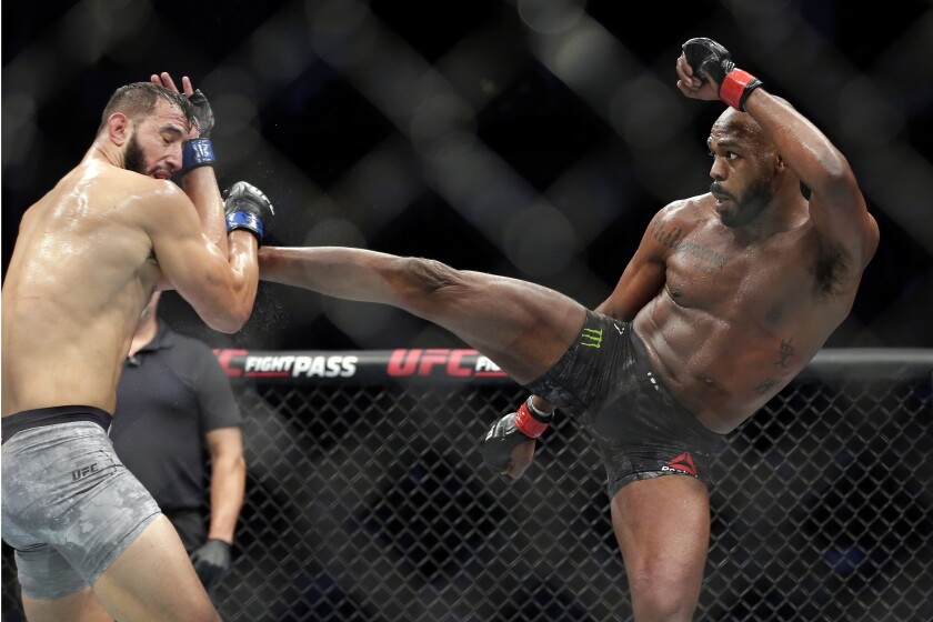 File0-Dominick Reyes, left, and Jon Jones, right, during a light heavyweight mixed martial arts bout at UFC 247 Saturday, Feb. 8, 2020, in Houston. The long-reigning UFC light heavyweight champion, Jones says he is vacating his title and likely moving up to heavyweight. Jones made the declarations on Twitter on Monday, Aug. 17, 2020, although the UFC didn't immediately confirm them.(AP Photo/Michael Wyke, File)