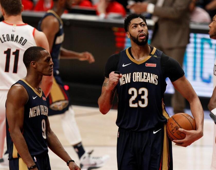 New Orleans Pelicans guard Rajon Rondo (L) and New Orleans Pelicans forward Anthony Davis (R) react after the conclusion of the Western Conference First Round NBA basketball game between the New Orleans Pelicans and the Portland Trail Blazers at the Moda Center in Portland, Oregon, USA, 14 April 2018. EFE