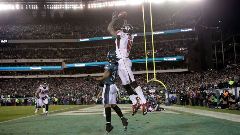 Atlanta's Julio Jones cannot catch a potential game-winning touchdown pass against Philadelphia's Jalen Mills in the final minute of their NFC divisional playoff game.