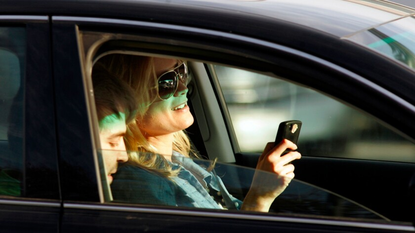According to a State Farm survey, many drivers look forward to texting and taking care of other business in their semiautonomous cars.