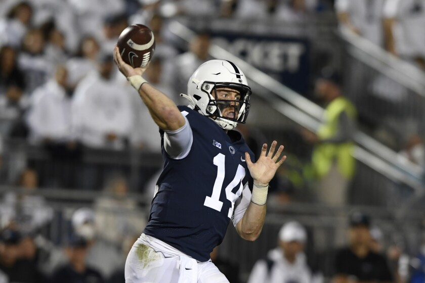 FILE - Penn State quarterback Sean Clifford (14) passes against Indiana in the first half of their NCAA college football game in State College, Pa., in this Saturday, Oct. 2, 2021, file photo. The key matchup in fourth-ranked Penn State's showdown with No. 3 Iowa pits the Nittany Lions' passing combo of Sean Clifford and Jahan Dotson against a defense that leads the nation with 12 interceptions.(AP Photo/Barry Reeger, File)
