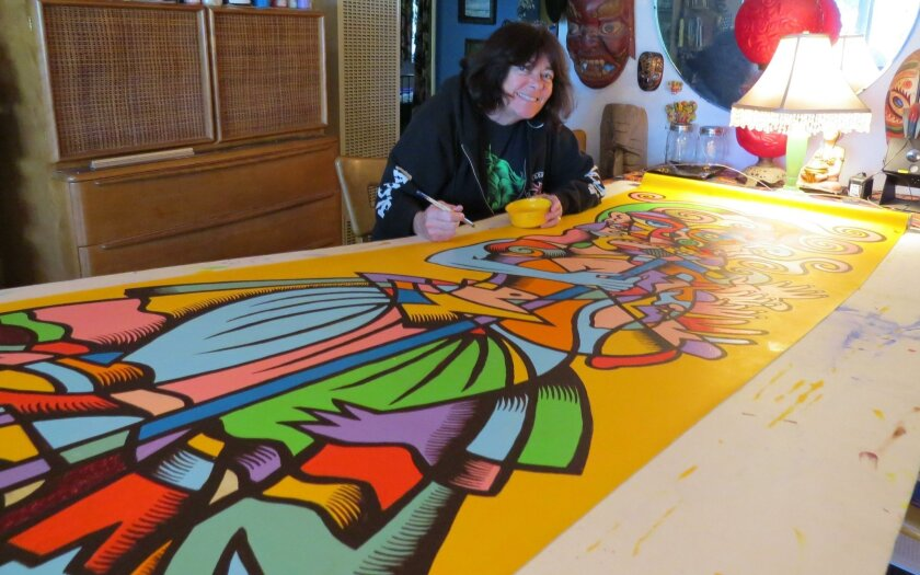 """Encinitas artist Mary Fleener paints a banner for the annual Arts Alive exhibit. Fleener's new exhibit """"American Music"""" charts her love of art and music."""