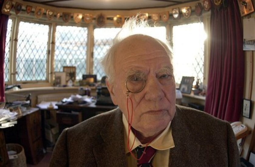 FILE - In this Dec. 29, 2000 file photo, British astronomer and broadcaster Patrick Moore at his home in Selsey, West Sussex, England. British astronomer and broadcaster Sir Patrick Moore has died, at age 89, his friends and colleagues have said, on Sunday, Dec. 9, 2012. (AP Photo/ Kirsty Wigglesworth/PA File) UNITED KINGDOM OUT NO SALES NO ARCHIVE