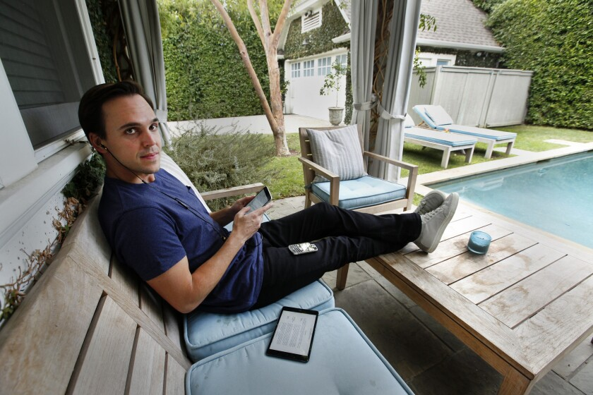 Chris Hollod, pictured working by his backyard pool, is billionaire investor Ron Burkle's right-hand man when it comes to venture capital investments.