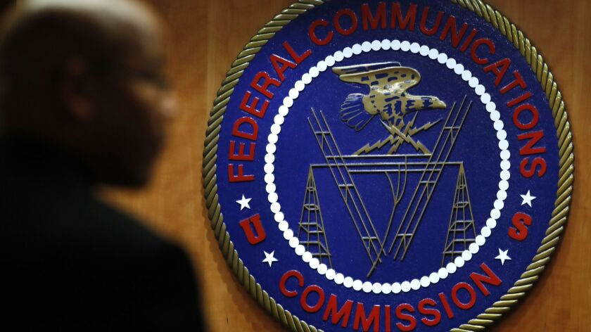 FILE- This Dec. 14, 2017, file photo, shows the seal of the Federal Communications Commission (FCC)