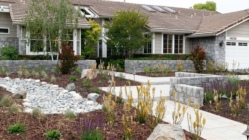 The new Poway front yard of Andrea and Bob Raibert has dry creek beds and drought-tolerant plants.