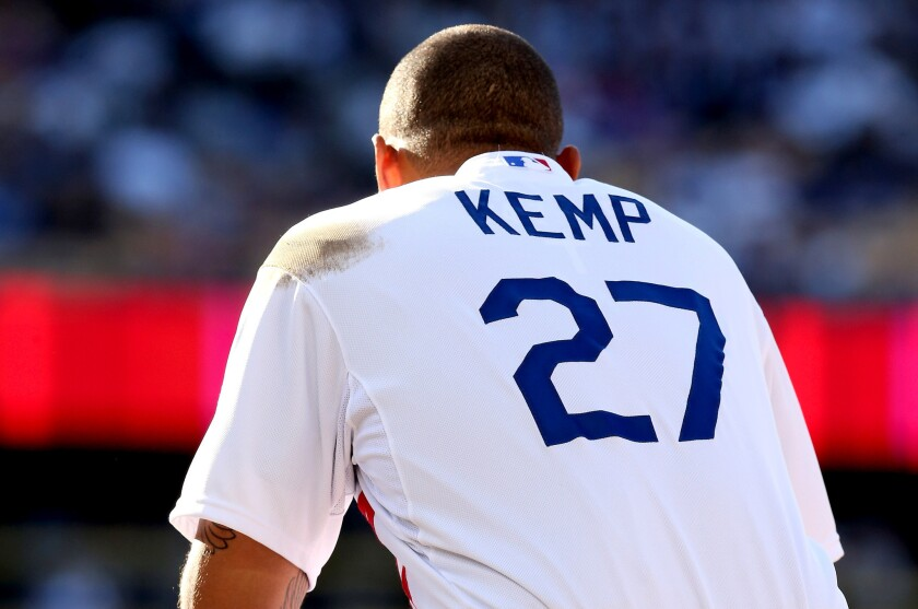 Dodgers' Matt Kemp squats a first base in the fifth inning during a pitching change by the St. Louis Cardinals.