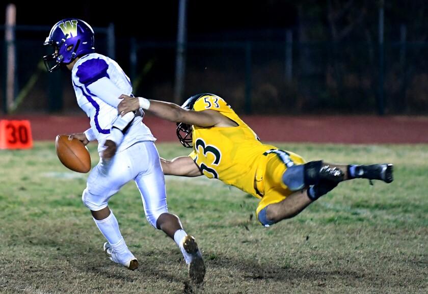 Paradise's Sam Gieg sacks Willows quarterback Odell Calzada during a regular-season game in October.