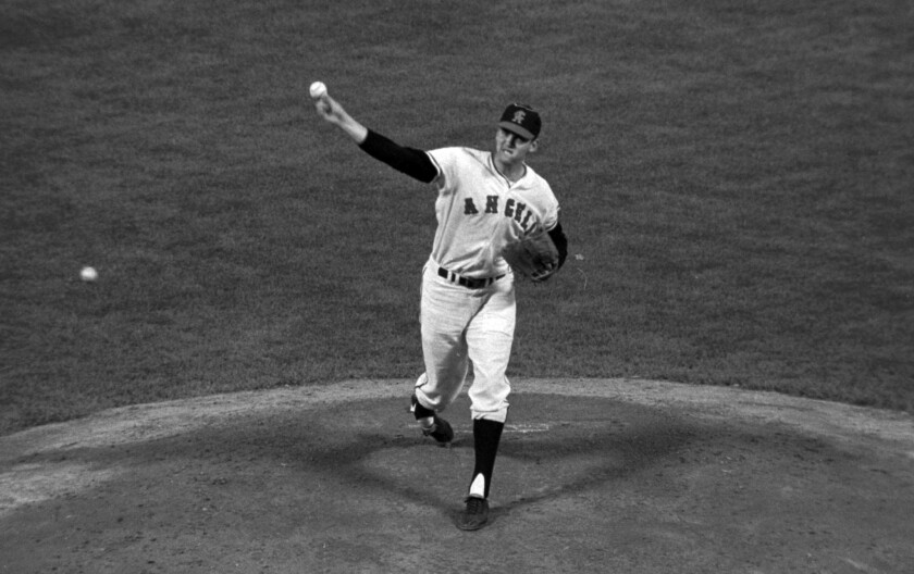 California Angels pitcher Dean Chance delivers a pitch during a 1966 game. Chance, who won the 1964 Cy Young Award and later pitched a no-hitter, died Sunday, Oct. 11, 2015. He was 74.