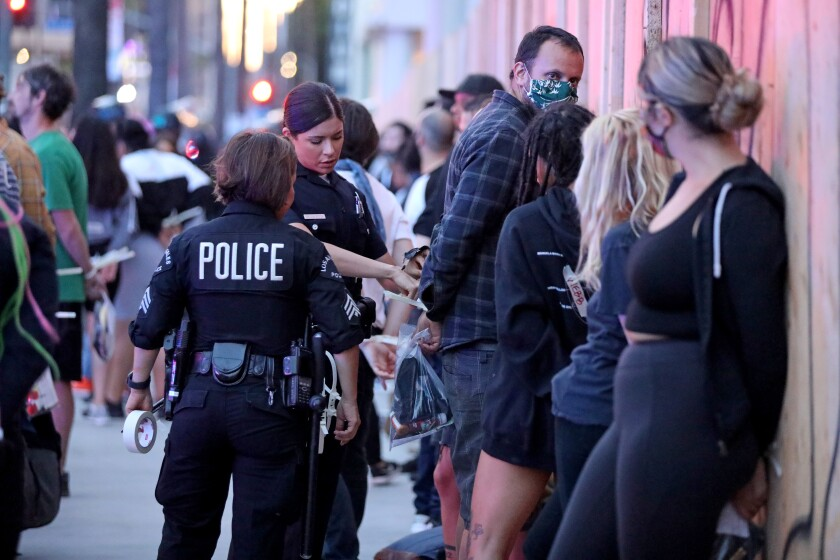 Los Angeles police officers gear up during protests that have rocked the city after the death of George Floyd in Minneapolis.