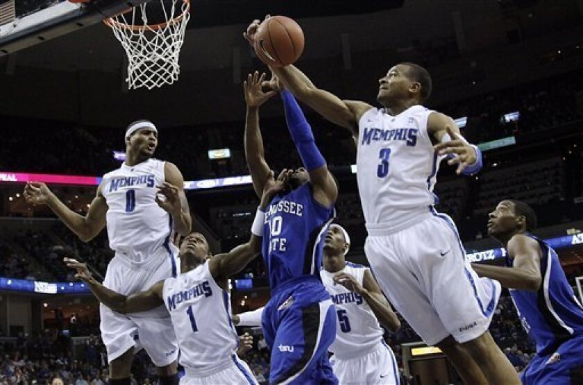 Tennessee State guard Wil Peters (10) gets buried by Memphis defenders Will Coleman (0), Joe Jackson (1), Will Barton (5) and Chris Crawford (3) during the first half of an NCAA college basketball game in Memphis, Tenn., Sunday, Jan. 2, 2011. (AP Photo/Lance Murphey)