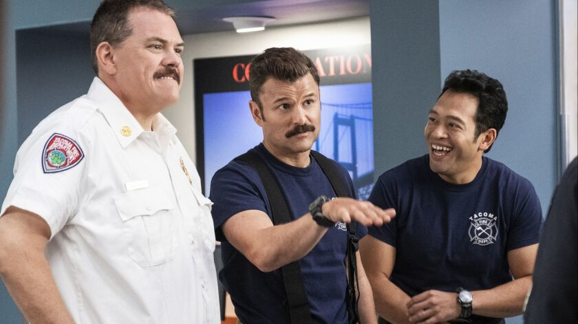 "Kevin Heffernan, left, Steve Lemme and Eugene Cordero in a scene from ""Tacoma FD."""