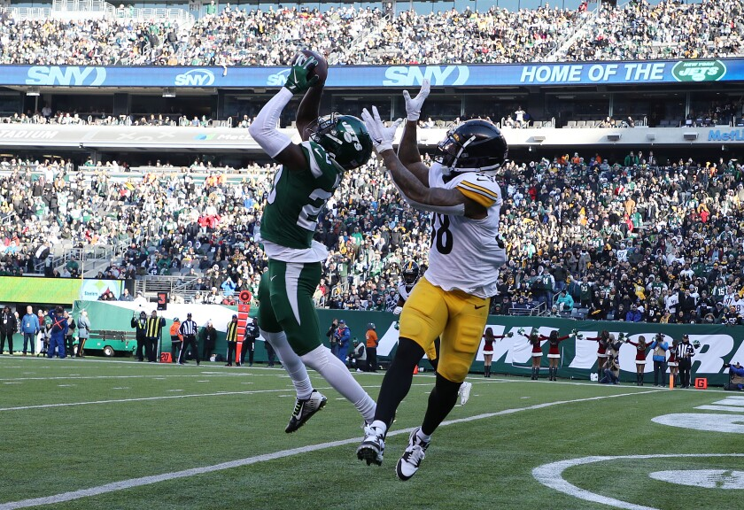 New York Jets safety Marcus Maye intercepts a pass in the end zone intended for Pittsburgh Steelers running back Jaylen Samuels.