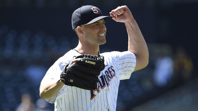 Padres pitcher Clayton Richard celebrates his 3-0, complete-game win Wednesday against the Phillies at Petco Park.