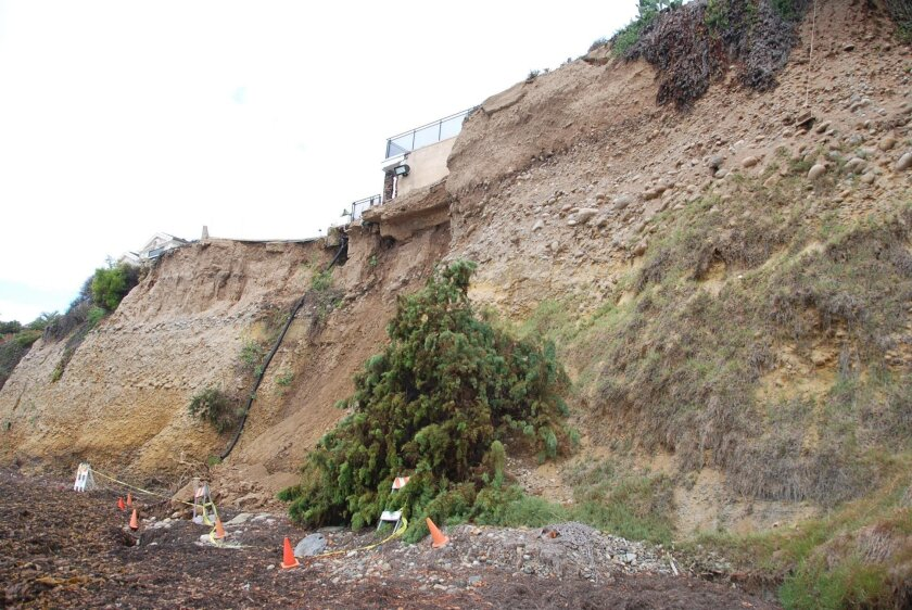 THEN: The bluff top property at 417 Sea Ridge Drive after the cliff collapse September 2015.