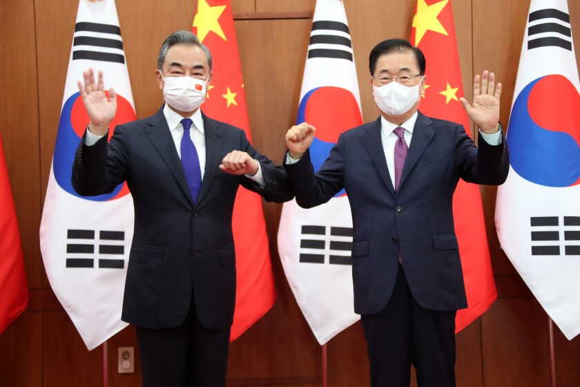 Chinese Foreign Minister Wang Yi, left, poses with his South Korean counterpart Chung Eui-yong for a photograph before their meeting at the Foreign Ministry in Seoul, South Korea, Wednesday, Sept. 15, 2021. The foreign ministers met Wednesday for talks expected to focus on North Korea and other regional security issues, two days after North Korea claimed to have tested a newly developed cruise missile. (Kim Seung-doo/Yonhap via AP)