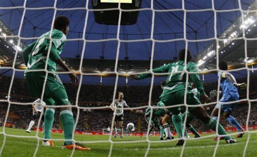 Germany's Simone Laudehr, center\ scores the goal during the group A match between Germany and Nigeria at the Women's Soccer World Cup in Frankfurt, Germany, Thursday, June 30, 2011. Germany won 1-0. (AP Photo/Matthias Schrader)