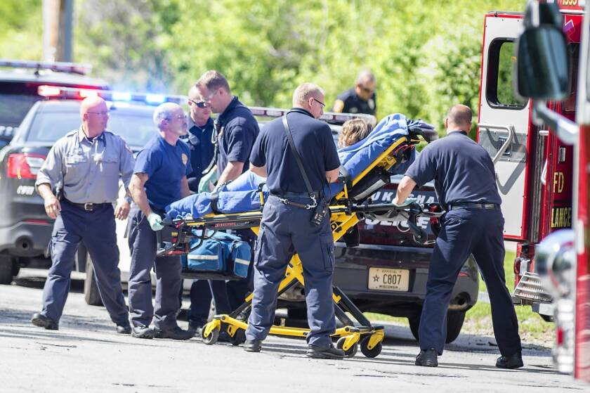A 12-year-old Payton Leutner is loaded into an ambulance after being found in a wooded area near Rivera Drive and Big Bend Road in Waukesha, Wis., in May 2014.